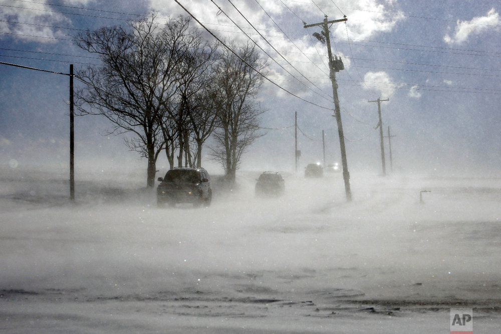 Drifting snow blows across PA-772 near Mount Joy in Lancaster County, Pa. Wednesday Jan. 30, 2019.  (AP Photo/Jacqueline Larma)