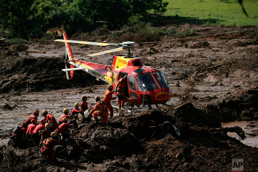 Firefighters are resupplied as they search for victims of the Vale dam collapse in Brumadinho, Brazil, Jan. 28, 2019. (AP Photo/Leo Correa)