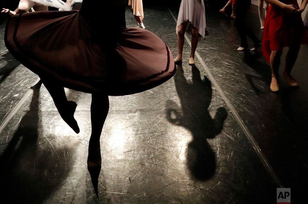 Young dancers warm up for the Youth America Grand Prix North America regional semi-finals in River Forest, Ill. (AP Photo/Nam Y. Huh)