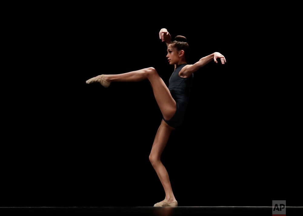 Audrey Henk performs in the Youth America Grand Prix North America regional semi-finals at Dominican University Performing Arts Center in River Forest, Ill. (AP Photo/Nam Y. Huh)