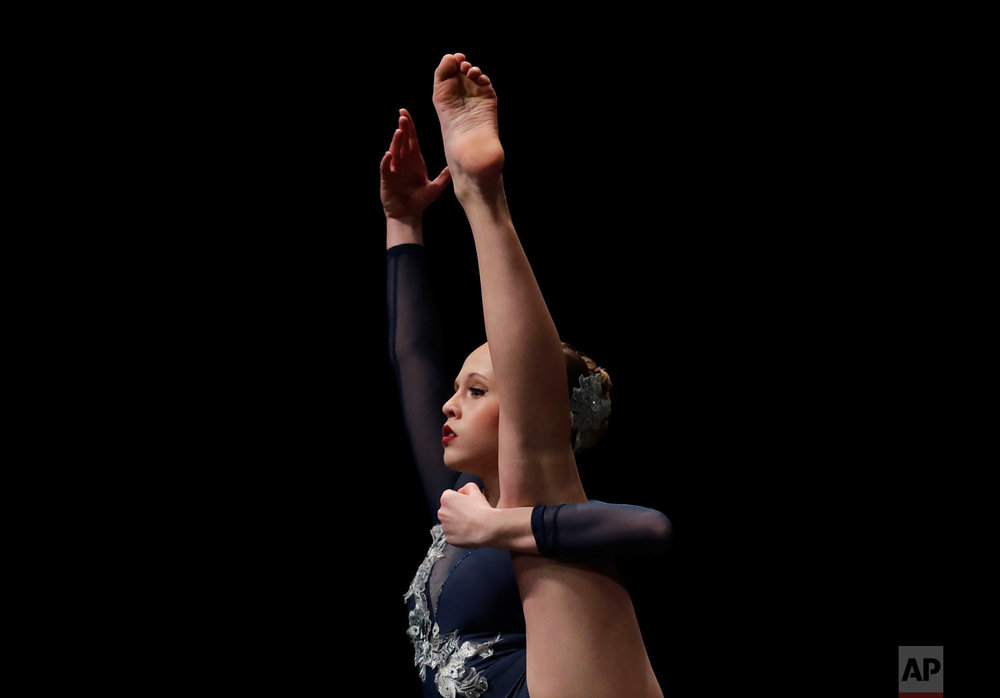 Lea Saputo performs in the Youth America Grand Prix North America regional semi-finals at Dominican University Performing Arts Center in River Forest, Ill. (AP Photo/Nam Y. Huh)