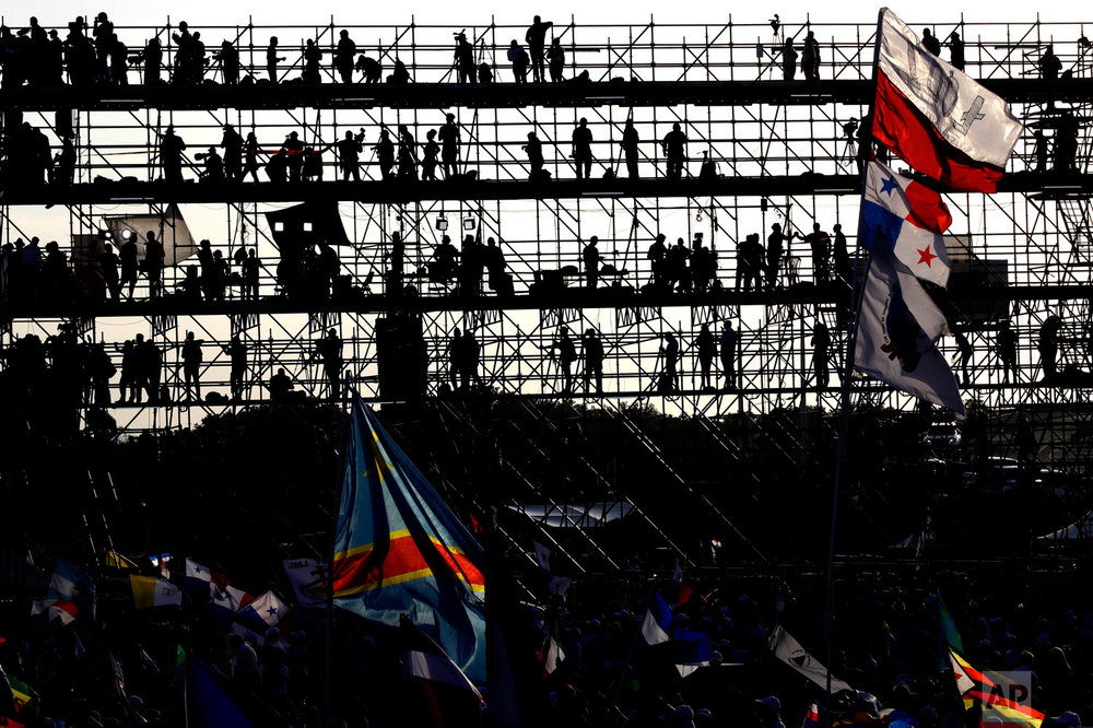 Journalists standing on a press scaffolding are silhouetted against the morning sky as they wait for Pope Francis to celebrate Mass in Panama City, Jan. 27, 2019. (AP Photo/Alessandra Tarantino)