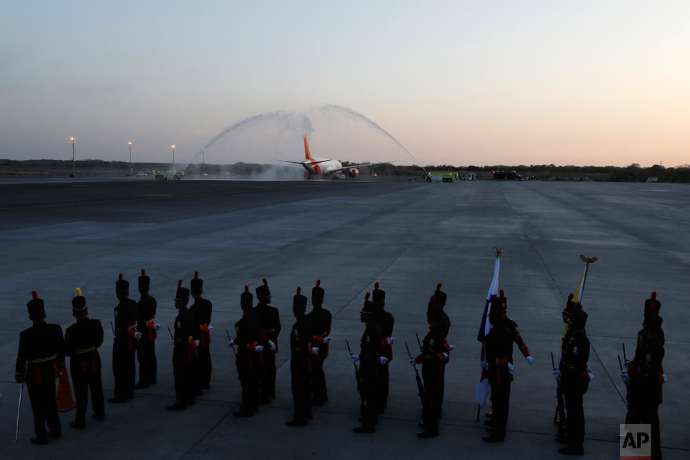 Pope Francis is given a water salute as his plane departs Tocumen Airport after a five-day visit in Panama City, Jan. 27, 2019. (AP Photo/Rebecca Blackwell)