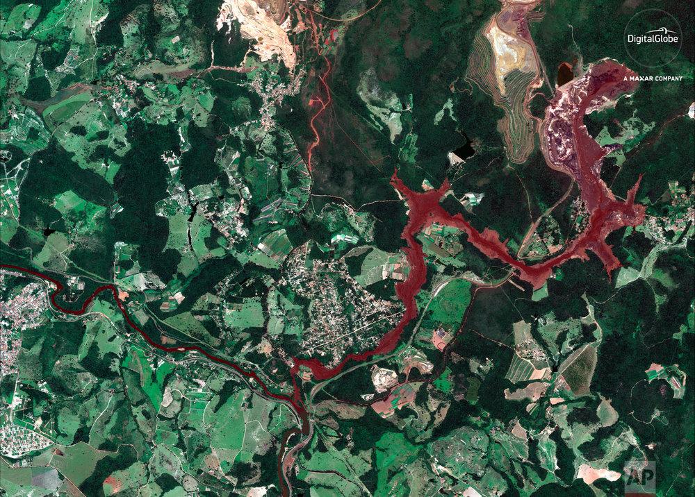 This Jan. 29, 2019 satellite image provided by DigitalGlobeshows mud flooding an area days after a Vale mine dam collapsed on Jan. 25, near Brumadinho, Brazil. (DigitalGlobe, a Maxar company via AP)
