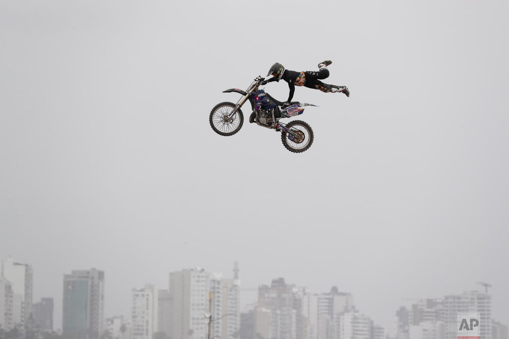 A rider performs a stunt during kick-off events for the Dakar Rally in Lima, Peru, Jan. 6, 2019. (AP Photo/Martin Mejia)