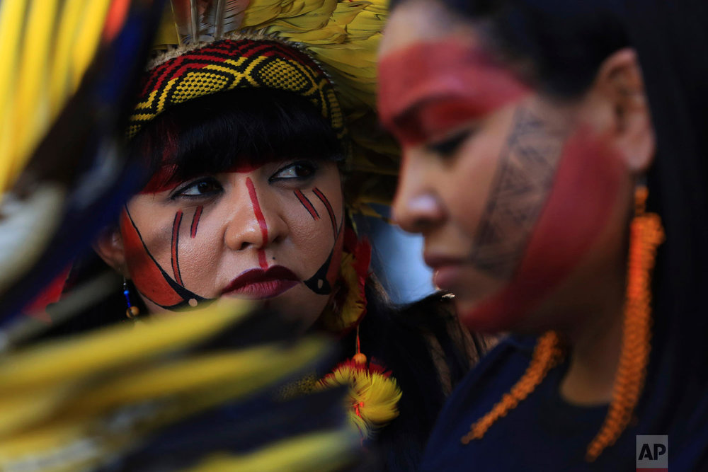 Indigenous women protest the government's policies on land and environmental protections outside the Agriculture Ministry in Brasilia, Brasil, Jan. 31, 2019. (AP Photo/Eraldo Peres)