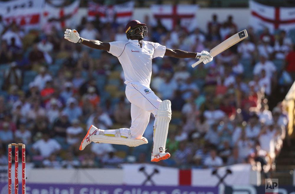 West Indies' captain Jason Holder celebrates his double century against England on the fourth day of their first cricket Test match in Bridgetown, Barbados, Jan. 25, 2019. (AP Photo/Ricardo Mazalan)