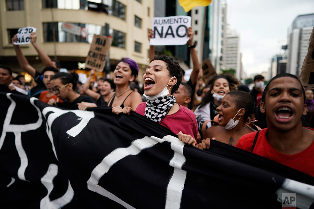 Demonstrators protest a hike in bus fare, almost 7.5 percent, in Sao Paulo, Brazil, Jan. 22, 2019. (AP Photo/Victor R. Caivano)