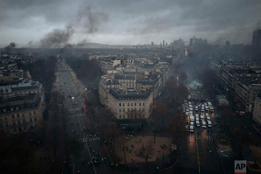 Avenues leading to the Arc de Triomphe are pictured from the top of the Arc de Triomphe on the Champs-Elysees avenue during a demonstration, Dec. 1, 2018 in Paris. (AP Photo/Kamil Zihnioglu)