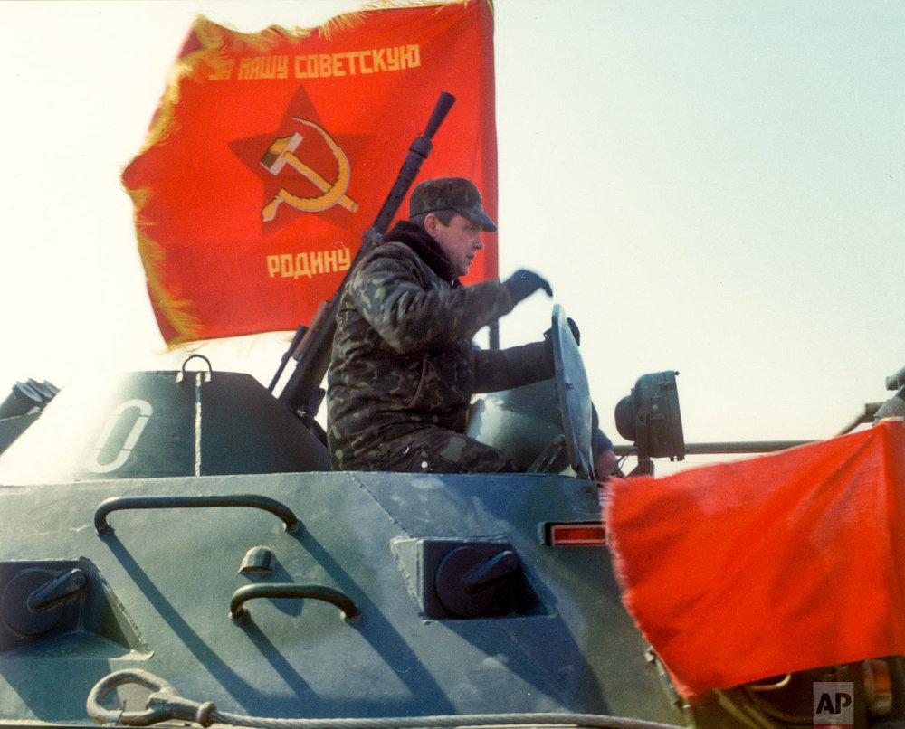 Lt. Gen. Boris Gromov, sits atop of an armored personnel carrier driving from Afghanistan across a bridge over the Amy Darya River, at Termez, Uzbekistan on Feb. 15, 1989. (Leonid Yakutin/Defense Ministry Press Service via AP)