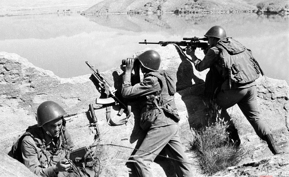 Soviet soldiers observe the highlands, while fighting Islamic guerrillas at an undisclosed location in Afghanistan on April 1988. (AP Photo/Alexander Sekretarev)