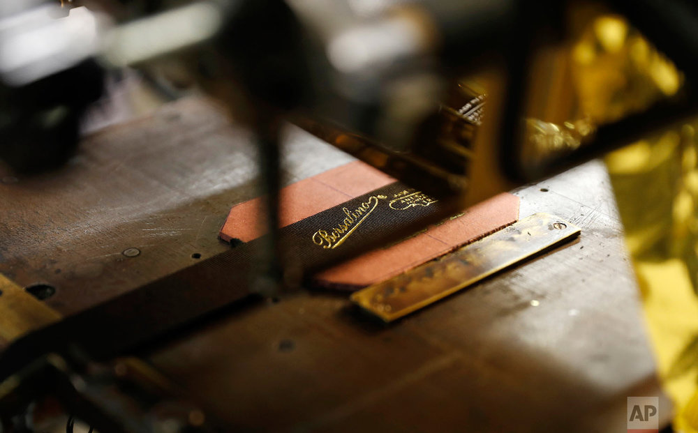A view of a label of Borsalino at its hat factory, in Spinetta Marengo, near Alessandria, Italy, Thursday, Jan. 17, 2019. (AP Photo/Antonio Calanni)