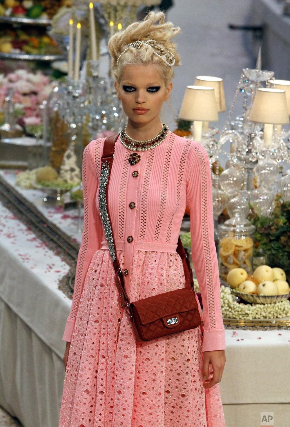 A model presents a creation by Lagerfeld in Paris, Dec. 6, 2011. (AP Photo/Remy de la Mauviniere)