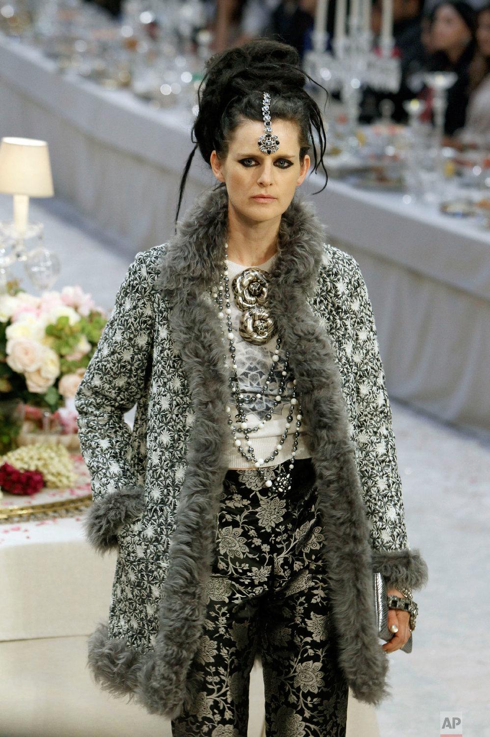 Model Stella Tennant presents a creation by Karl Lagerfeld in Paris, Dec. 6, 2011. (AP Photo/Remy de la Mauviniere)