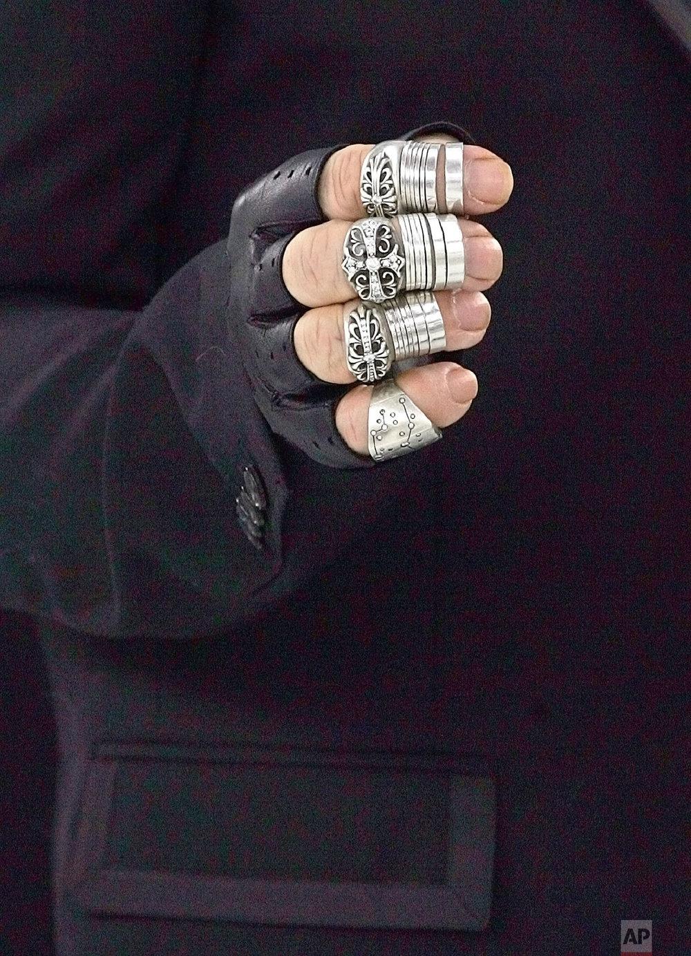 Lagerfeld's hand is seen backstage Jan. 25, 2005 in Paris. (AP Photo/Jerome Delay)
