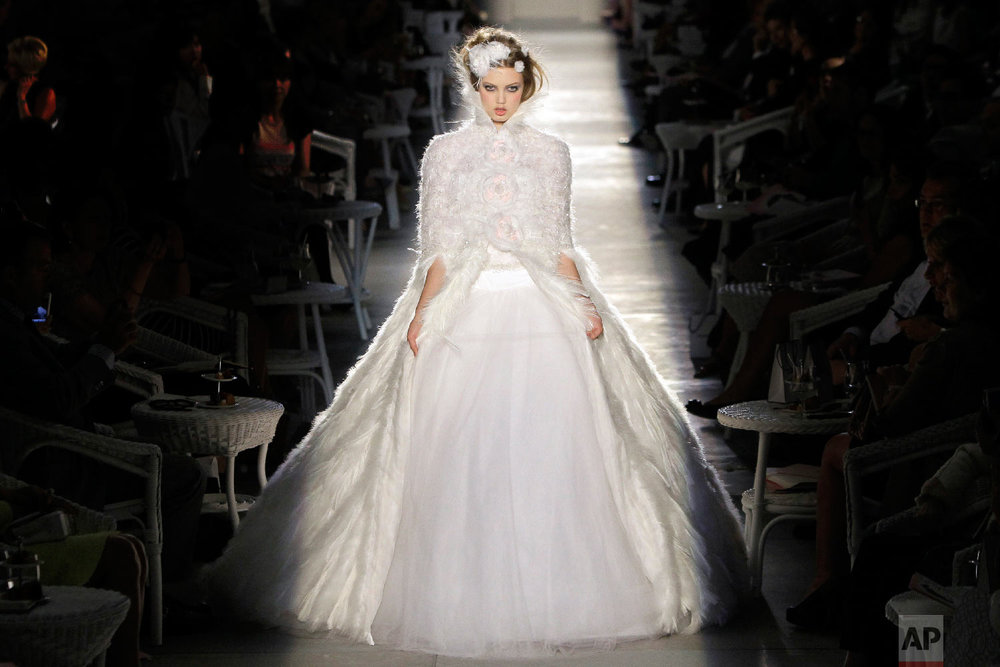 A model wears a creation of Chanel by fashion designer Karl Lagerfeld during his Women's Fall Winter 2013 haute couture fashion collection in Paris, France, July 3, 2012. (AP Photo/Francois Mori)