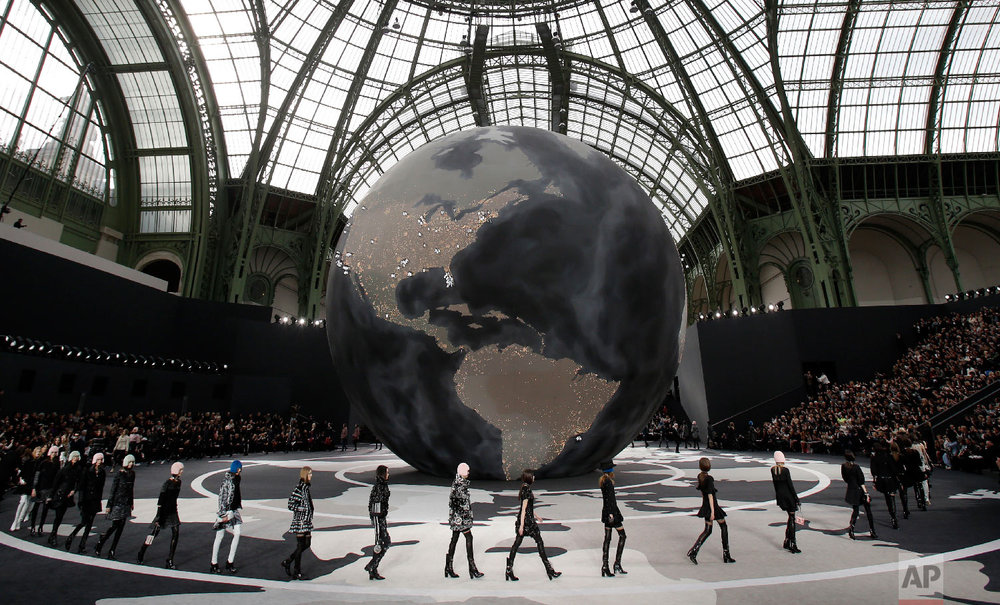 Models wear creations by German fashion designer Karl Lagerfeld for Chanel's Fall/Winter 2013-2014 ready to wear collection, in Paris, March, 5, 2013. (AP Photo/Christophe Ena)