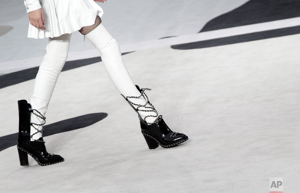A model wears a creation by German fashion designer Karl Lagerfeld for Chanel's Fall/Winter 2013-2014 ready to wear collection, in Paris, March, 5, 2013. (AP Photo/Christophe Ena)