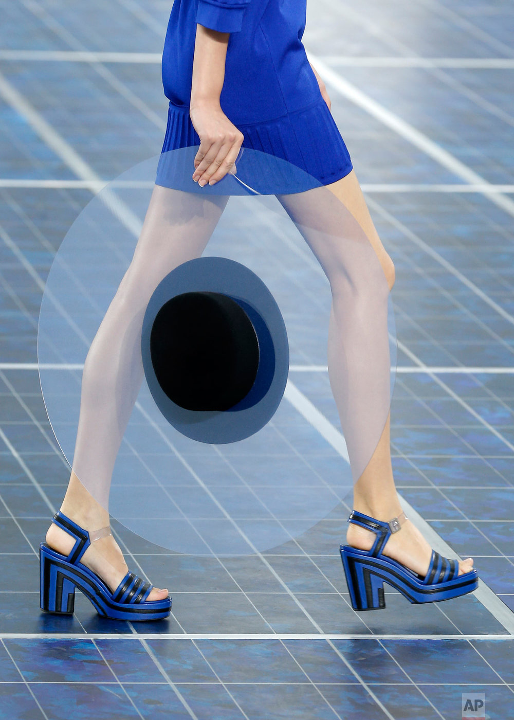 A model wears a creation byLagerfeld in Paris, Oct. 2, 2012. (AP Photo/Jacques Brinon)