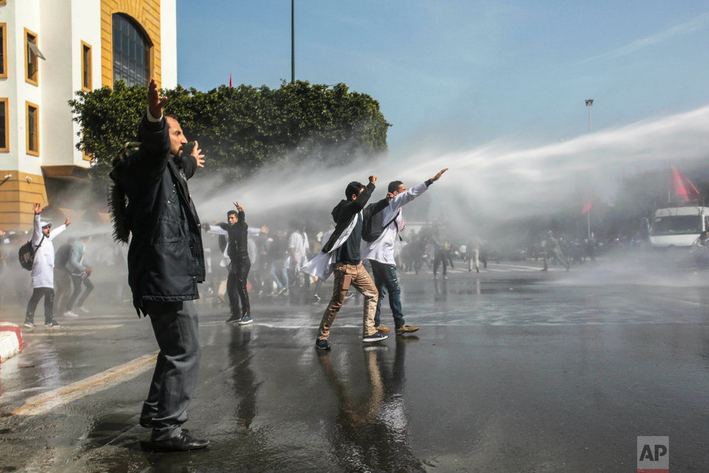 Security forces use water cannons to disperse protesting teachers, in Rabat, Morocco, Feb. 20, 2019. (AP Photo/Mosa'ab Elshamy)