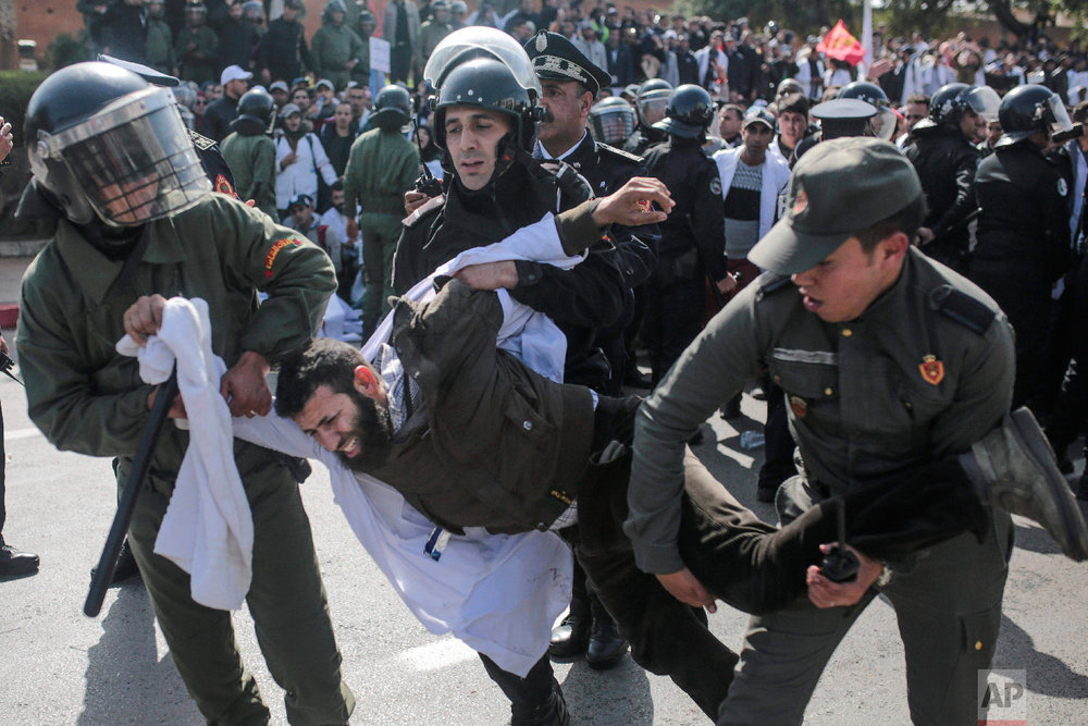 Security forces detain a protesting teacher during a demonstration in Rabat, Morocco, Feb. 20, 2019. (AP Photo/Mosa'ab Elshamy)