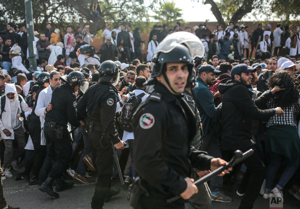 Security forces attempt to control protesting teachers during a demonstration in Rabat, Morocco, Feb. 20, 2019. (AP Photo/Mosa'ab Elshamy)