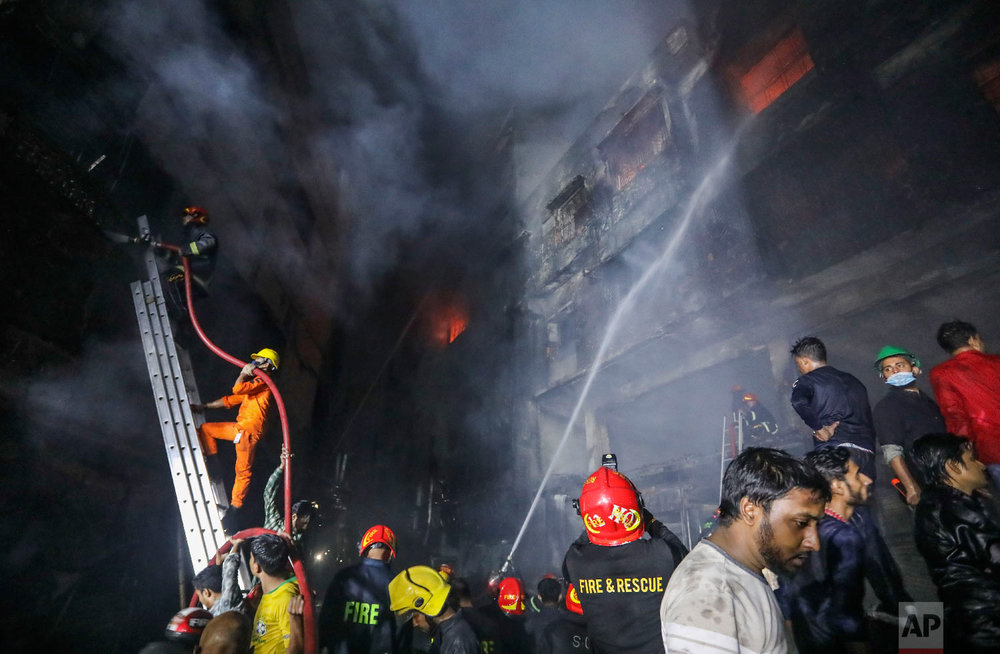 Firefighters work to douse flames in Dhaka, Bangladesh, Thursday, Feb. 21, 2019. (AP Photo/Zabed Hasnain Chowdhury)