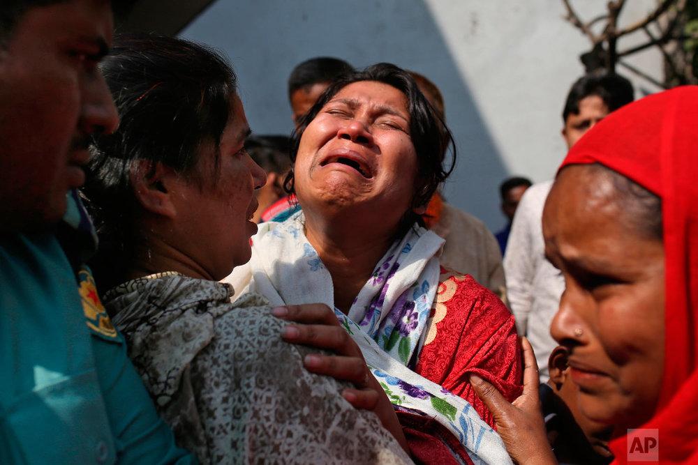 A Bangladeshi woman mourns the death of a relative in a fire, outside a morgue in Dhaka, Bangladesh, Thursday, Feb. 21, 2019. (AP Photo/Rehman Asad)