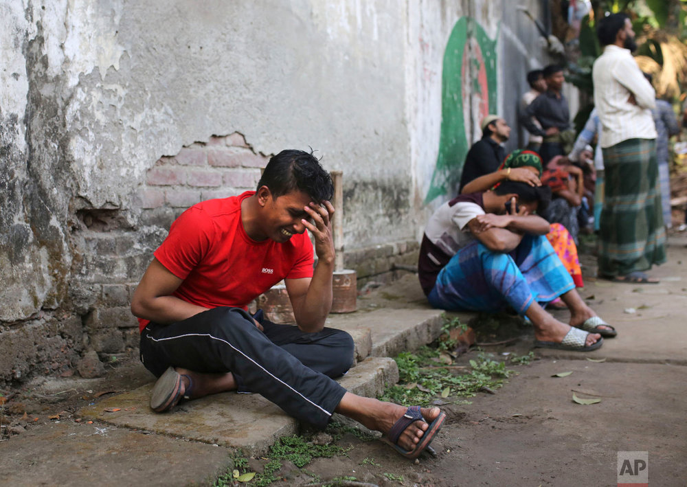 An unidentified Bangladeshi cries by the site of a fire that broke out late Wednesday in closely set buildings in Dhaka, Bangladesh, Thursday, Feb. 21, 2019. (AP Photo/Rehman Asad)