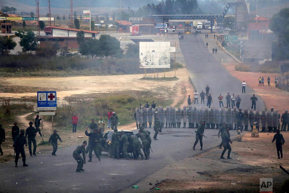 Venezuela's Bolivarian National Guards block the border between Brazil and Venezuela, Saturday, Feb. 23, 2019. (AP Photo/Ivan Valencia)