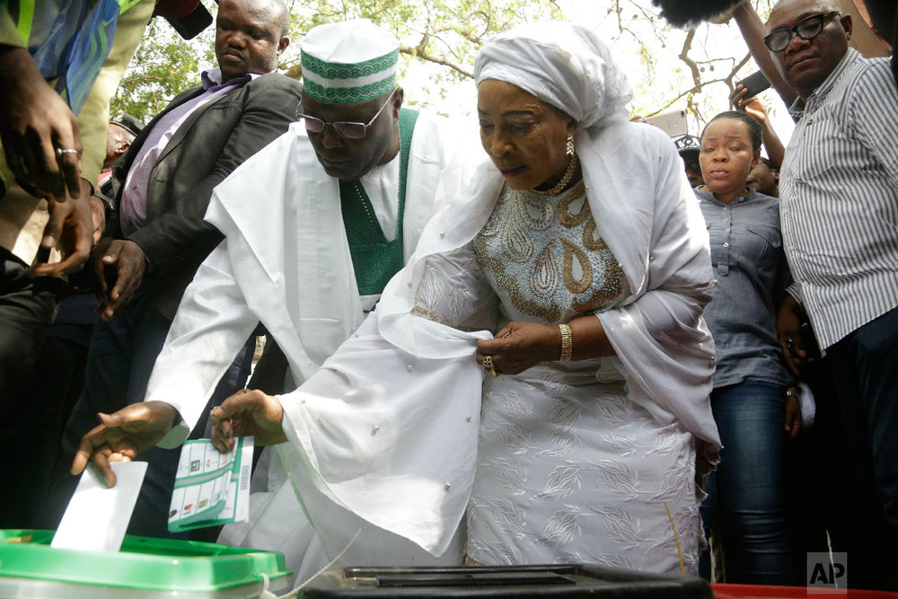 Opposition's presidential candidate Atiku Abubakar, left, and his wife Titi Abubakar, right, cast their votes in Yola Nigeria, Feb. 23, 2019. (AP Photo/Sunday Alamba)