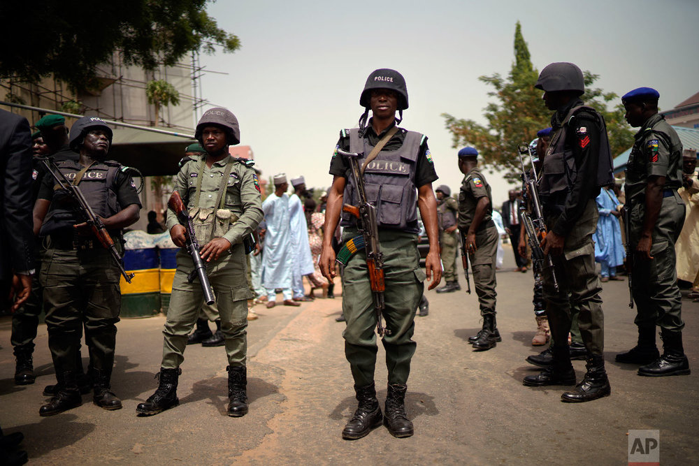 Nigerian police guard the entrance of the All Progressives Congress (APC) party headquarters where Incumbent President Muhammadu Buhari holds an emergency meeting with senior members of the party in Abuja, Nigeria, Feb. 18, 2019. (AP Photo/Jerome Delay)
