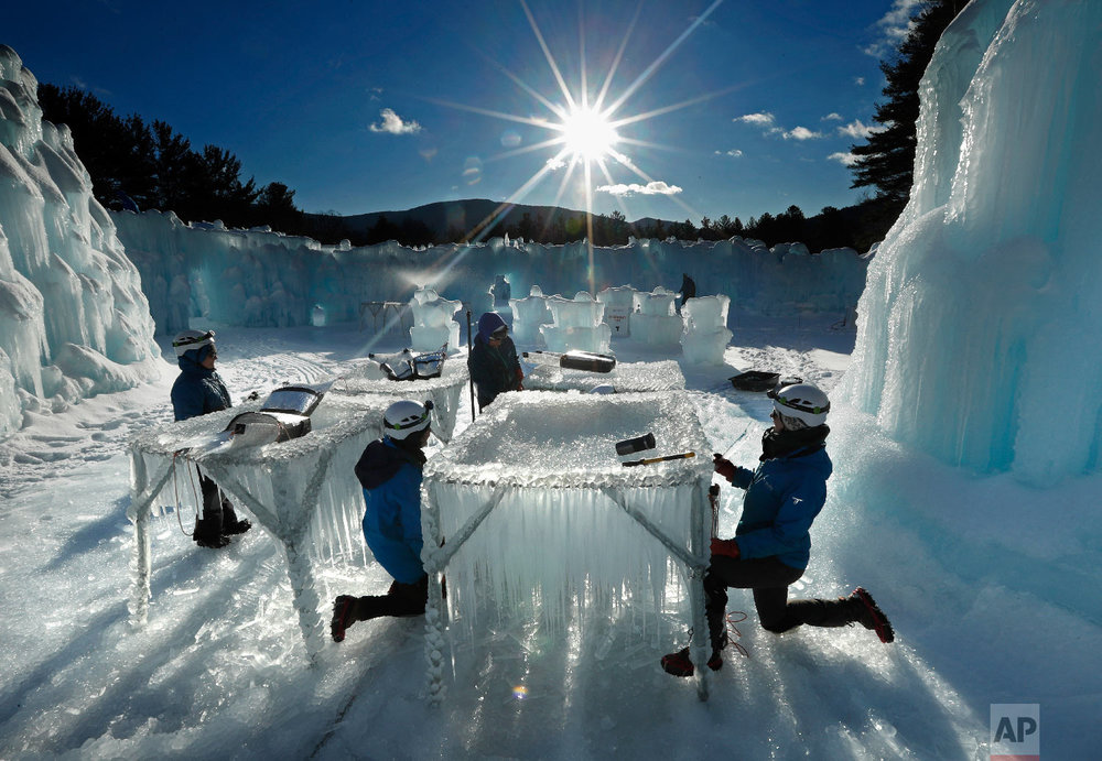 Icicles are harvested for use in growing the walls at Ice Castles in North Woodstock, N.H., on Jan. 28, 2019. (AP Photo/Robert F. Bukaty)