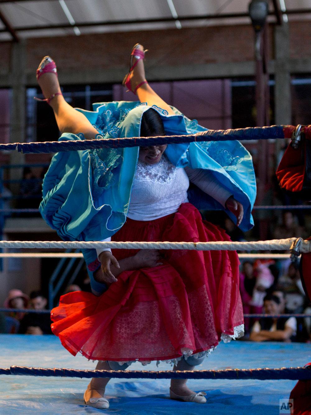 Veteran cholita wrestler Jennifer Dos Caras, 45, competes in the ring with Randy Four in El Alto, Bolivia, Jan. 21, 2019.