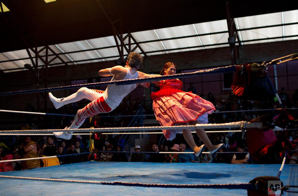Veteran cholita wrestler Jennifer Dos Caras, 45, competes in the ring with Randy Four in El Alto, Bolivia, Jan. 21, 2019. (AP Photo/Juan Karita)