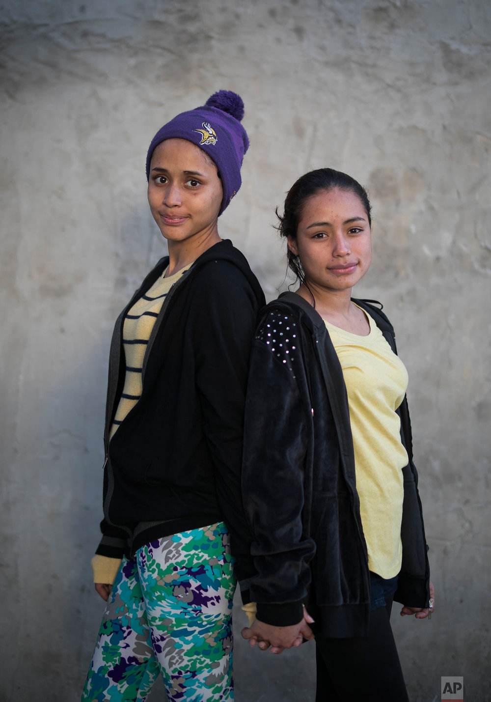 El Salvador migrant sisters 15-year-old Milagro de Jesus Henriquez Ayala, who is pregnant, and Xiomara, 13, pose for a portrait at the Agape World Mission shelter in Tijuana, Mexico, Feb. 6, 2019. (AP Photo/Emilio Espejel)