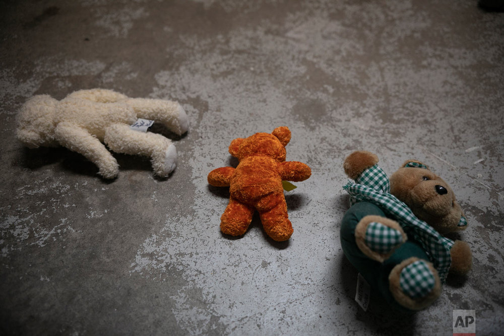 Teddy bears lie on the floor of the dormitory where Honduran migrant Josue Mejia Lucero's 3-year-old nephew Jefferson is staying with his mother, at Agape World Mission shelter in Tijuana, Mexico, Feb. 7, 2019 photo. (AP Photo/Emilio Espejel)