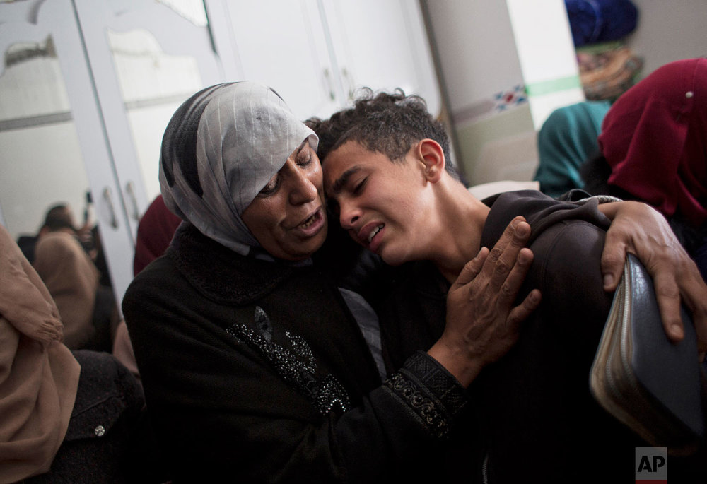 Relatives of Palestinian teenager Hassan Shalabi mourn his death at the family home during his funeral in Nuseirat refugee camp, central Gaza Strip, Feb 9, 2019. (AP Photo/Khalil Hamra)