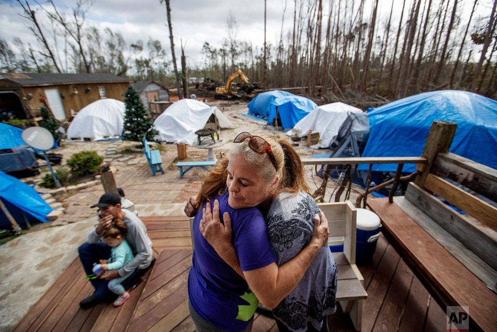 "Diahn ""Shelly"" Summers, right, embraces Lori Hogan, who is currently living in a tent in Summers' backyard months after Hurricane Michael hit in Youngstown, Fla, Wednesday, Jan. 23, 2019. (AP Photo/David Goldman)"