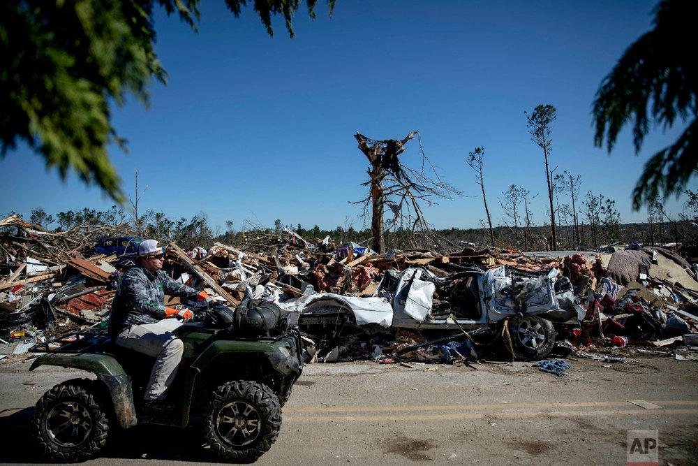 Debris sits on the side of a road in a neighborhood devastated by a tornado in Beauregard, Ala., March 5, 2019. (AP Photo/David Goldman)