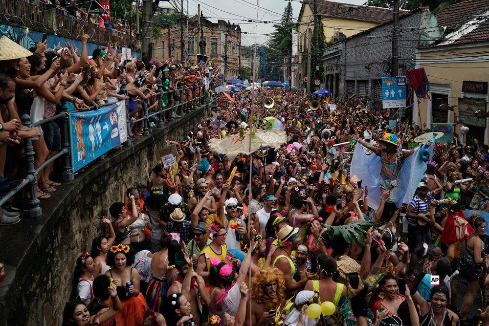 "Revelers perform during the ""Ceu na Terra"" or Heaven on Earth street party in Rio de Janeiro, Brazil, Saturday, March 2, 2019. (AP Photo/Leo Correa)"