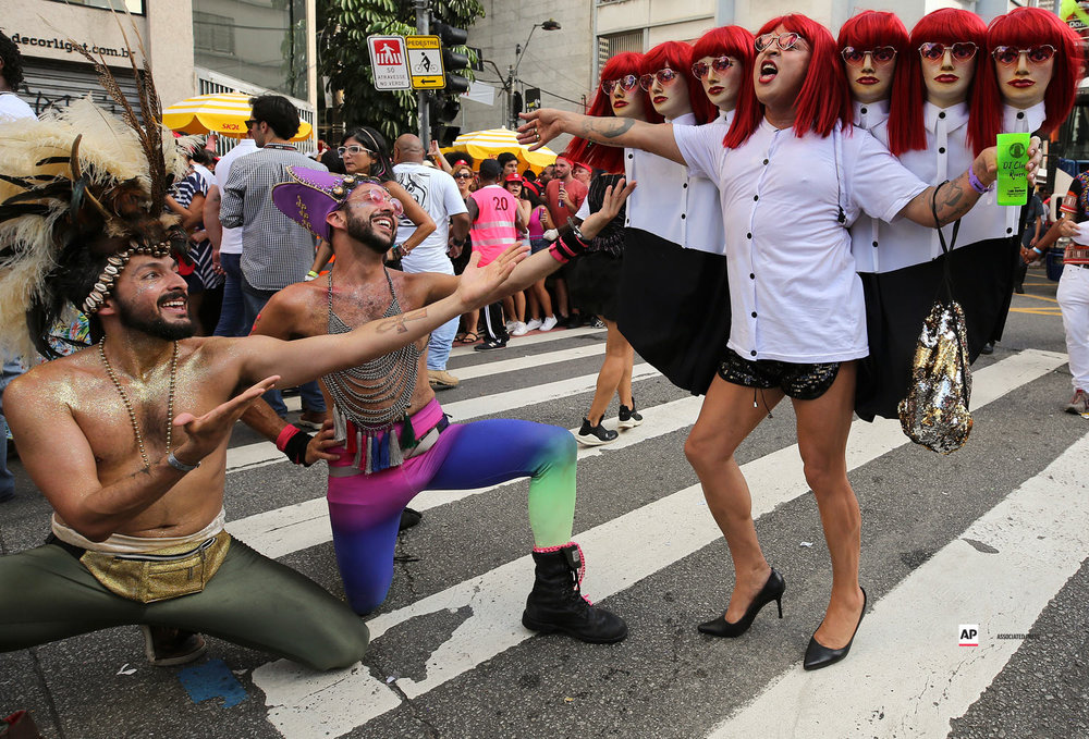 """Carnival revelers perform during the Academicos do Baixo Augustaa carnival """"bloco"""" parade in Sao Paulo, Brazil, Sunday, Feb. 24, 2019. (AP Photo/Andre Penner)"""