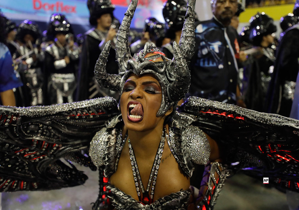 A dancer from the Imperio de Casa Verde samba school performs during a carnival parade in Sao Paulo, Brazil, Saturday, March 2, 2019. (AP Photo/Andre Penner)