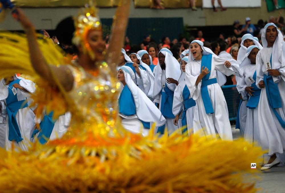 Performers from the Unidos da Tijuca samba school parade during Carnival celebrations at the Sambadrome in Rio de Janeiro, Brazil, Monday, March 4, 2019. (AP Photo/Silvia Izquierdo)
