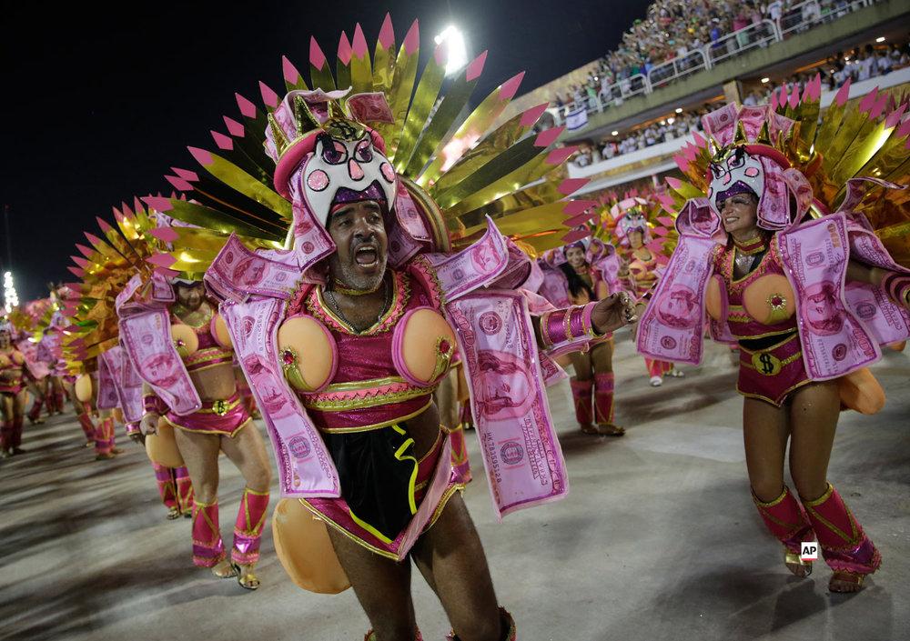 Performers from the Sao Clemente samba school parade during Carnival celebrations at the Sambadrome in Rio de Janeiro, Brazil, Monday, March 4, 2019. (AP Photo/Silvia Izquierdo)