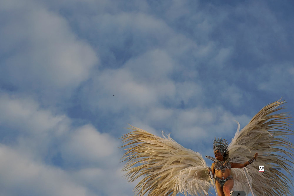 A performer from the Mocidade samba school parades on a float during Carnival celebrations at the Sambadrome in Rio de Janeiro, Brazil, Tuesday, March 5, 2019. (AP Photo/Leo Correa)