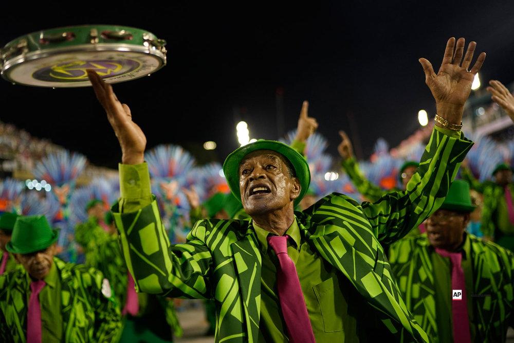 A performer from the Mangueira samba school parades during Carnival celebrations at the Sambadrome in Rio de Janeiro, Brazil, Tuesday, March 5, 2019. (AP Photo/Leo Correa)