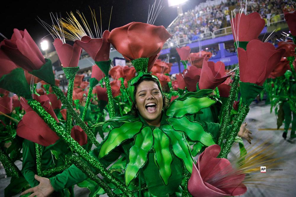 A performer from the Imperio Serrano samba school parades during Carnival celebrations at the sambadrome in Rio de Janeiro, Brazil, Sunday, March 3, 2019. (AP Photo/Silvia Izquierdo)