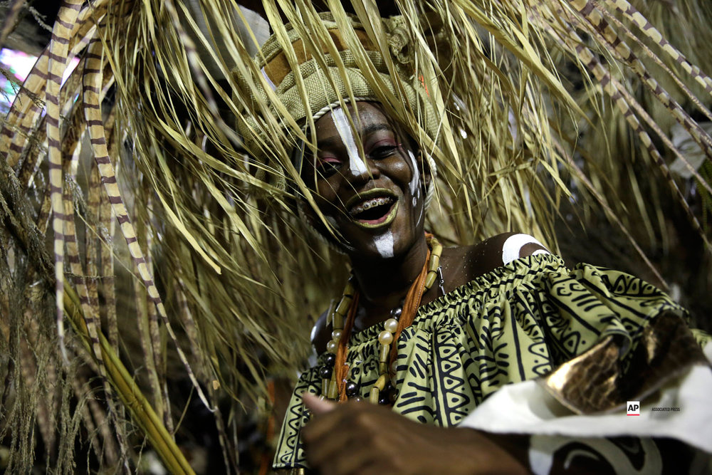 A performer from the Mangueira samba school parades during Carnival celebrations at the Sambadrome in Rio de Janeiro, Brazil, Tuesday, March 5, 2019. (AP Photo/Silvia Izquierdo)