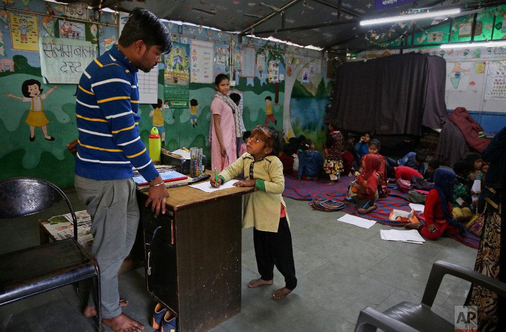 7-year-old Farmaan studies at Salaam Baalak Trust, an NGO working for street children, in New Delhi, India, on In this Jan. 24, 2019. (AP Photo/Altaf Qadri)